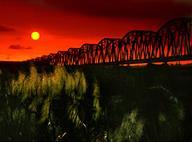 下淡水溪鐵橋夕陽照片